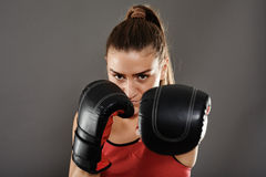 Kickbox woman left jab Stock Photography