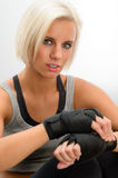 Kickbox woman put on protective gloves fitness Stock Images