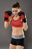 Kickbox young woman in gloves Stock Images