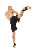 Kickboxer executing a powerful kick Stock Photo