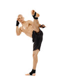 Kickboxer executing a powerful kick Stock Image