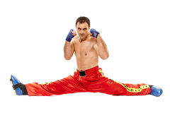 Kickboxer isolated executing a split Stock Images