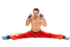 Kickboxer isolated executing a split Royalty Free Stock Photo
