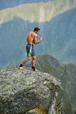 Kickboxer or muay thai fighter training on a mountain cliff Royalty Free Stock Photography