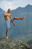 Kickboxer or muay thai fighter training on a mountain cliff Stock Photography