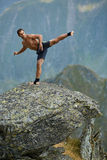 Kickboxer or muay thai fighter training on a mountain cliff Royalty Free Stock Images