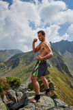 Kickboxer or muay thai fighter training on a mountain Royalty Free Stock Photos