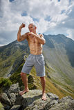 Kickboxer or muay thai fighter training on a mountain Royalty Free Stock Photo