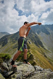 Kickboxer or muay thai fighter training on a mountain Royalty Free Stock Image