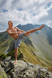 Kickboxer or muay thai fighter training on a mountain Royalty Free Stock Photography