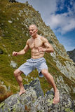 Kickboxer or muay thai fighter training on a mountain Stock Image