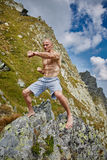 Kickboxer or muay thai fighter training on a mountain Stock Photo