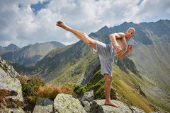 Kickboxer or muay thai fighter training on a mountain Royalty Free Stock Images