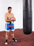 Kickboxer with punch bag Stock Photo