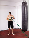 Kickboxer with punch bag Royalty Free Stock Photography