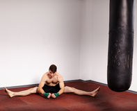 Kickboxer with punch bag Royalty Free Stock Image
