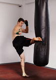 Kickboxer with punch bag Royalty Free Stock Images