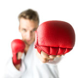 Kickboxer with red boxing gloves performing a martial arts punch Royalty Free Stock Photography