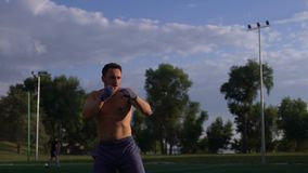 Kickboxer shadow boxing as exercise for preparation to the fight. stock video