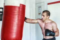 Kickboxer training in the gym Stock Photo