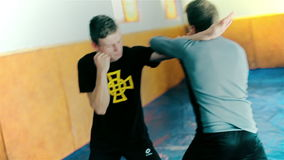 Kickboxer training at the punching bag. HD stock video footage