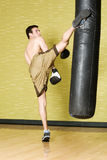 Kickboxer working out on punching bag Royalty Free Stock Photo