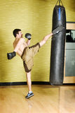 Kickboxer working out on punching bag Royalty Free Stock Photography