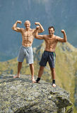 Kickboxers or muay thai fighters on a mountain cliff Royalty Free Stock Photos