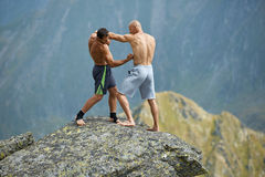 Kickboxers or muay thai fighters training on a mountain cliff Royalty Free Stock Photo