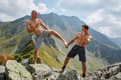Kickboxers or muay thai fighters training in the mountains Royalty Free Stock Photography