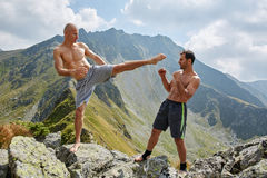 Kickboxers or muay thai fighters training in the mountains Stock Photo