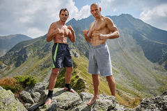 Kickboxers or muay thai fighters training in the mountains Stock Photography