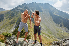 Kickboxers or muay thai fighters training in the mountains Royalty Free Stock Photo