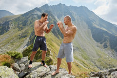 Kickboxers or muay thai fighters training in the mountains Stock Photos