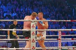 Kickboxers in ring. Lucian Danilencu (Romania) vs. Jantje Siersma (Holland) at at Superkombat Final Elimination, october 15, Piatra Neamt Royalty Free Stock Photo