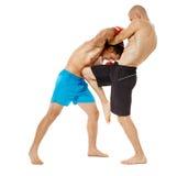 Kickboxers sparring on white Stock Photos
