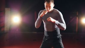 A kickboxers training exercise in slow motion. stock video