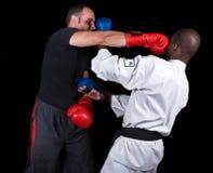 Kickboxing contra karate imagen de archivo libre de regalías