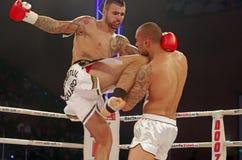Kickboxing fight. Bogdan Stoica (Romania) vs. Leon Miedema (Suriname) – superfight 92 kg at Superkombat Final Elimination, october 15, Piatra Neamt Stock Photography