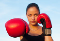 Kickboxing girl exercising in the nature Royalty Free Stock Photo