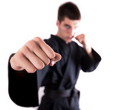 Kickboxing man. A man doing kickboxing and throwing a punch. Focus on the fist Stock Photos