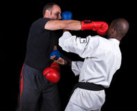 Kickboxing versus karate Royalty Free Stock Image
