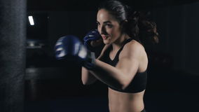 Kickboxing woman training punching bag in fitness studio stock video footage