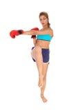 Kickboxings jonge vrouw Stock Afbeelding