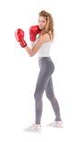 Kickboxingsmeisje stock afbeelding