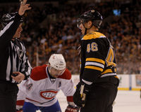 Kicked out of a Face-Off. Boston Bruins forward is kicked out of the face-off circle against Canadiens center Tomas Plekanec Royalty Free Stock Image