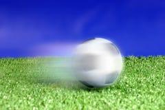 Kicked soccer ball. Sport theme: Kicked ball on grass stock photography