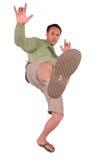 kicken gör mannen arkivfoto