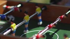 Kicker. Invisible playing table football. Unknown playing foosball. Table soccer. Foosball. Invisible playing table football. Unknown playing foosball. The stock video