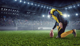 Kicker player on position. Mixed media Royalty Free Stock Image
